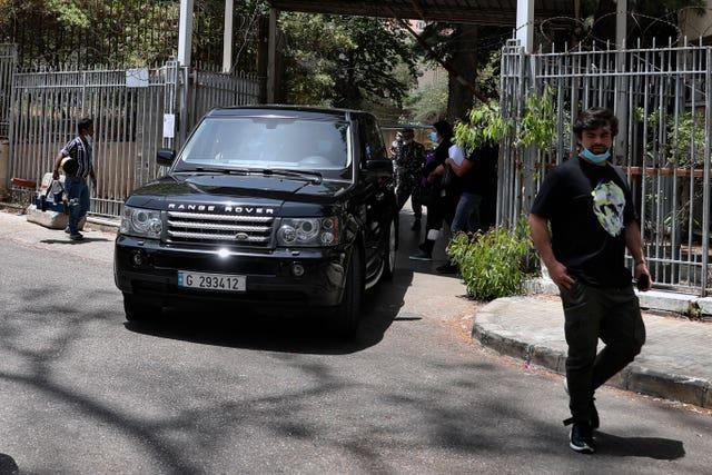 One of Carlos Ghosn's vehicles leaves the Justice Palace in Beirut, Lebanon