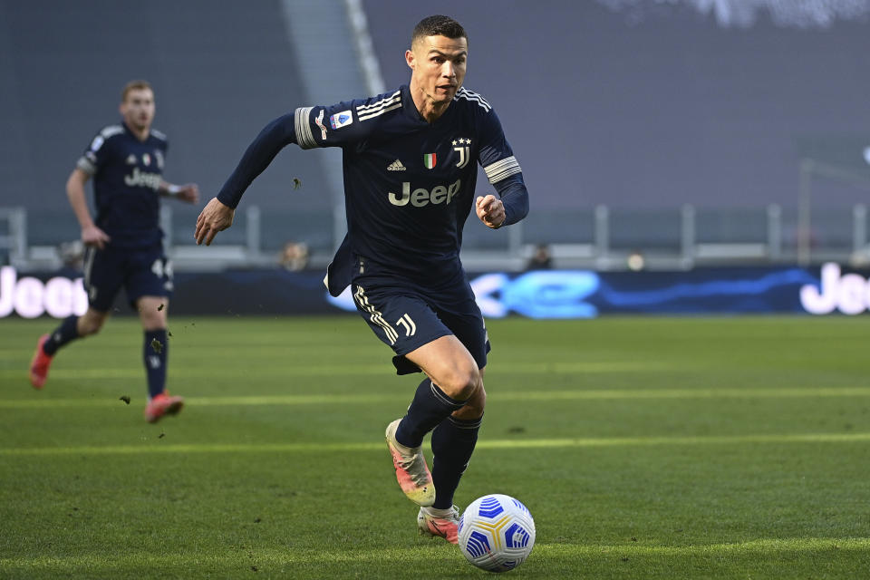 Juventus' Cristiano Ronaldo runs with the ball during the Serie A soccer match between Juventus and Benevento at the Allianz stadium in Turin, Italy, Sunday, March 21, 2021. (Marco Alpozzi/LaPresse via AP)