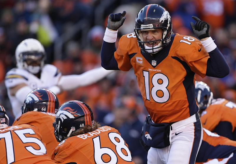 Denver Broncos quarterback Peyton Manning (18) calls an audible at the line of scrimmage against the San Diego Chargers in the first quarter of an NFL AFC division playoff football game, Sunday, Jan. 12, 2014, in Denver. (AP Photo/Charlie Riedel)