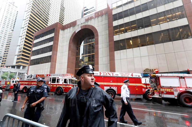 New York City Police and Fire Department personnel secure the scene in front of a building in midtown Manhattan where a helicopter crash landed, June 10, 2019.