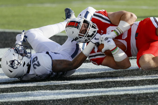 Cincinnati tight end Josiah Deguara, right, scores a touchdown against Connecticut defensive back Tyler Coyle (25) during the first half of an NCAA college football game, Saturday, Nov. 9, 2019, in Cincinnati. (AP Photo/John Minchillo)