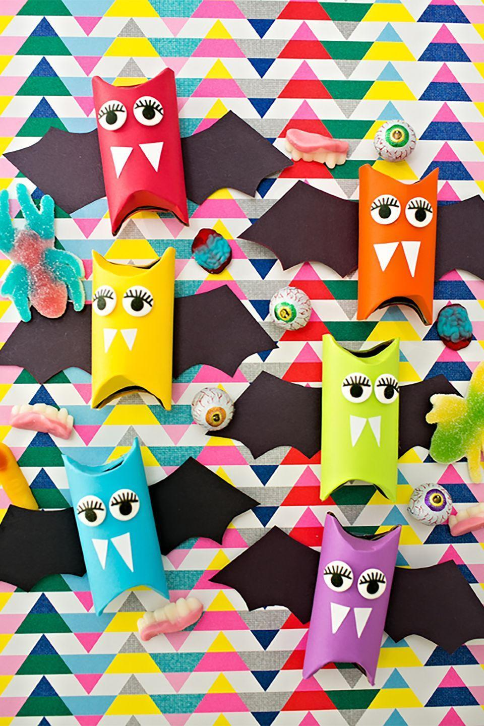 """<p>These colorful creatures are filled with goodies that will make kids go absolutely batty. </p><p><strong>Get the tutorial at <a href=""""https://www.hellowonderful.co/post/RAINBOW-PAPER-TUBE-BATS--HALLOWEEN-CRAFT-FOR-KIDS"""" rel=""""nofollow noopener"""" target=""""_blank"""" data-ylk=""""slk:Hello, Wonderful"""" class=""""link rapid-noclick-resp"""">Hello, Wonderful</a>.</strong> </p>"""