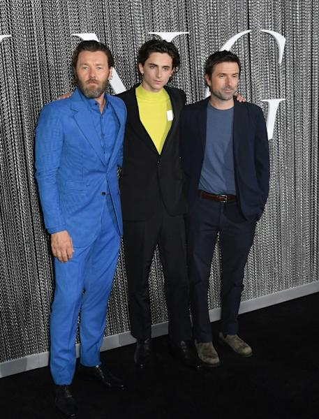 """US actor Timothee Chalamet is flanked by """"The King"""" co-star Joel Edgerton (left) and director David Michod, both Australians, in Busan, South Korea"""