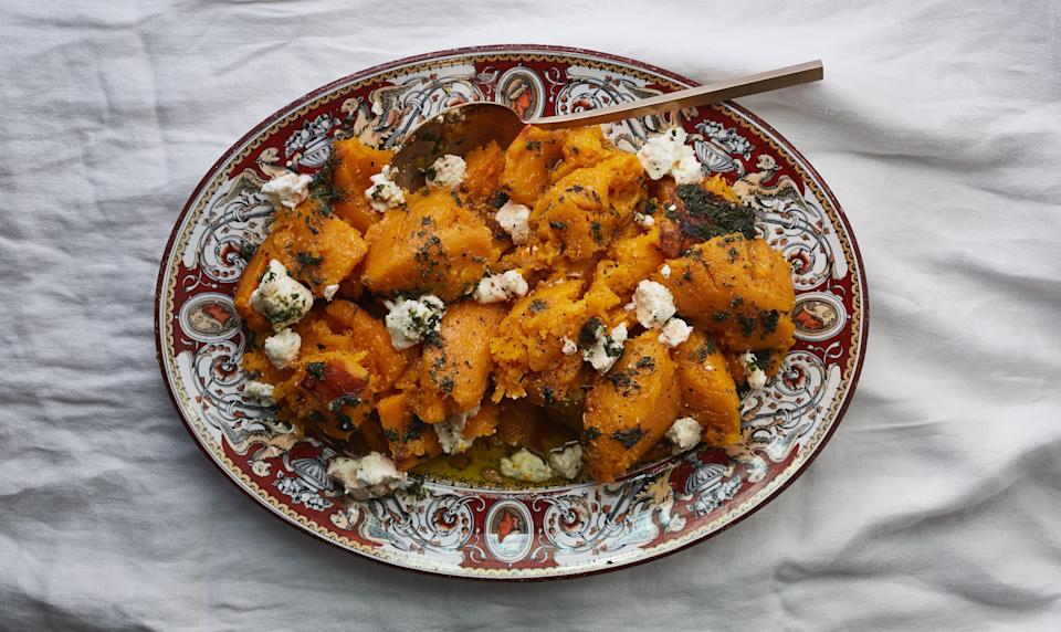 "This roasted butternut squash recipe is perfect for a dinner party—serving on a large platter encourages second helpings and all the half portions, tastes, and just-one-more bites that follow. <a href=""https://www.bonappetit.com/recipe/roasted-butternut-with-herb-oil-and-goat-cheese?mbid=synd_yahoo_rss"" rel=""nofollow noopener"" target=""_blank"" data-ylk=""slk:See recipe."" class=""link rapid-noclick-resp"">See recipe.</a>"