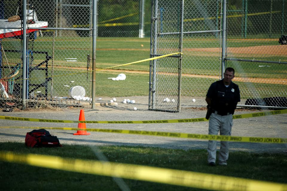 A police officer mans a shooting scene.