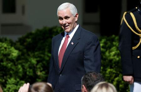 FILE PHOTO U.S. Vice President Pence arrives for a swearing-in ceremony in the Rose Garden of the White House in Washington