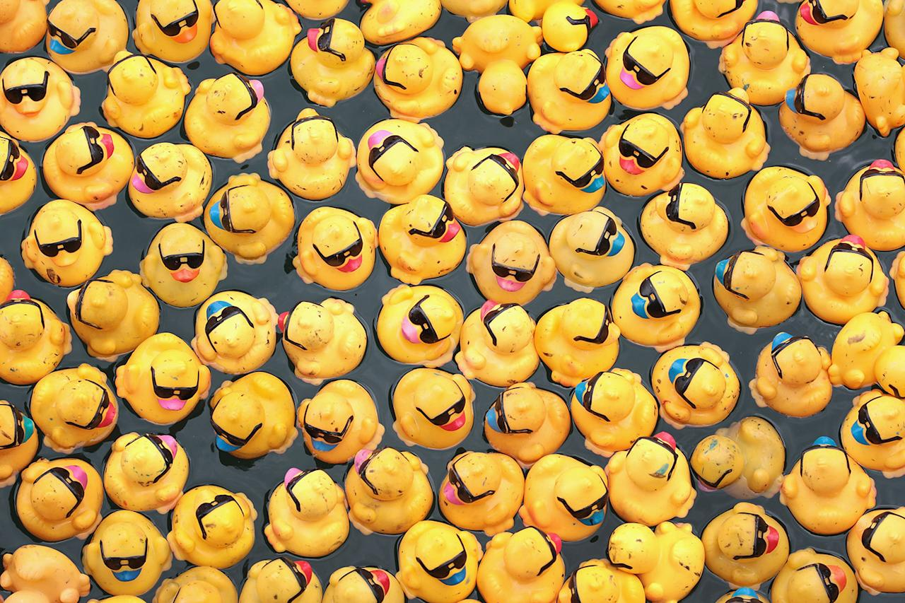 <p>Rubber ducks float down the Chicago River during the Windy City Rubber Ducky Derby on August 3, 2017 in Chicago, Illinois. (Photo: Scott Olson/Getty Images) </p>