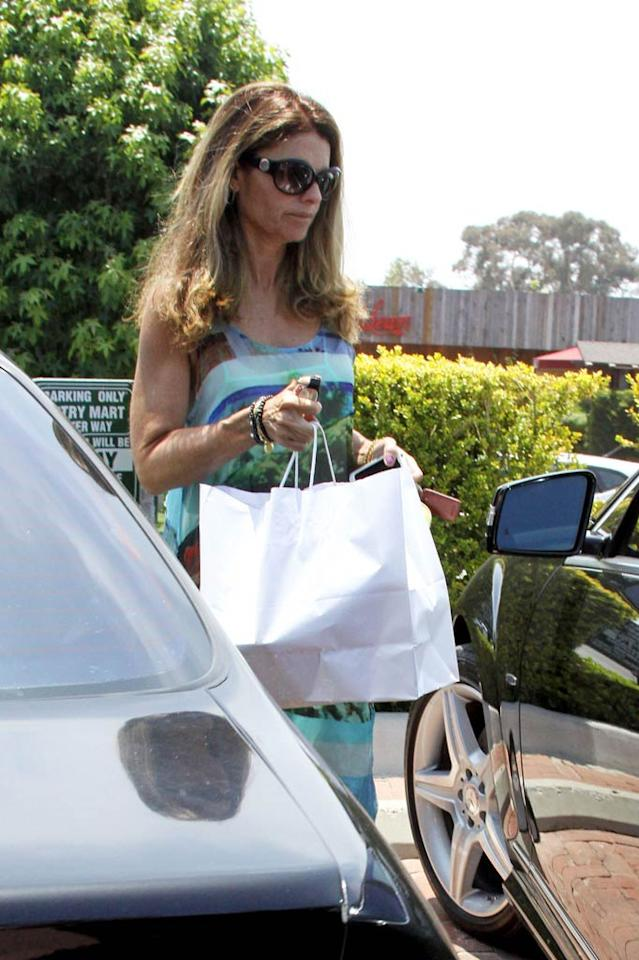"""Even the former first lady of California, Maria Shriver, made a stop at the star-studded shopping venue. We don't know what's in that bag, but we're pretty sure it isn't a gift for Arnold ... <a href=""""http://www.pacificcoastnews.com/"""" target=""""new"""">PacificCoastNews.com</a> - July 9, 2011"""