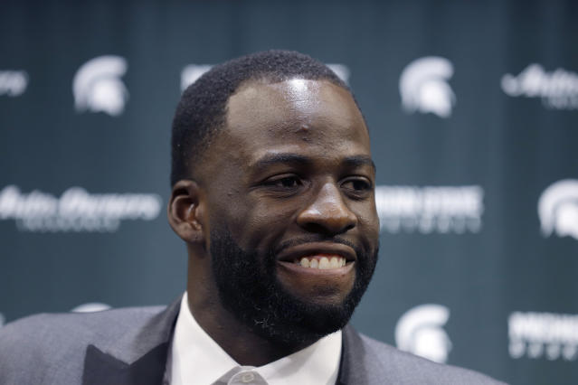 Former Michigan State and current Golden State Warriors player Draymond Green talks to reporters before an NCAA college basketball Tuesday, Dec. 3, 2019, in East Lansing, Mich. (AP Photo/Al Goldis)