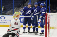 Tampa Bay Lightning left wing Ondrej Palat (18) celebrates with teammates center Steven Stamkos (91) and center Brayden Point (21) after scoring against Chicago Blackhawks goaltender Collin Delia (60) during the second period of an NHL hockey game Friday, Jan. 15, 2021, in Tampa, Fla. (AP Photo/Chris O'Meara)