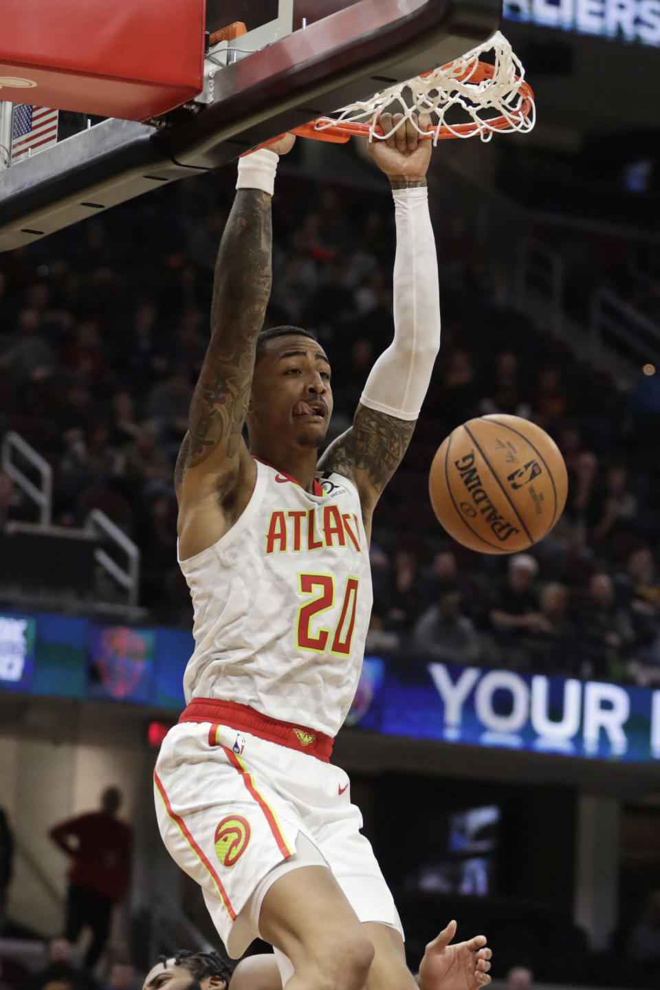 Atlanta Hawks' John Collins dunks the ball against the Cleveland Cavaliers in the second half of an NBA basketball game, Wednesday, Feb. 12, 2020, in Cleveland. The Cavaliers won 127-105. (AP Photo/Tony Dejak)