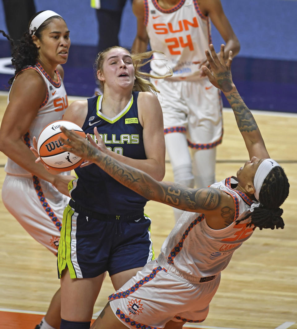 Connecticut Sun forward Emma Cannon goes down after a collision with Dallas Wings center Bella Alaire during a WNBA basketball game Tuesday, June 22, 2021 at Mohegan Sun Arena in Uncasville, Conn. (Sean D. Elliot/The Day via AP)