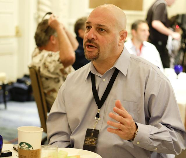 Cleveland Borwns head coach Mike Pettine answers questions from reporters during the AFC head coaches breakfast at the NFL football annual meeting in Orlando, Fla., Tuesday, March 25, 2014. (AP Photo/John Raoux)