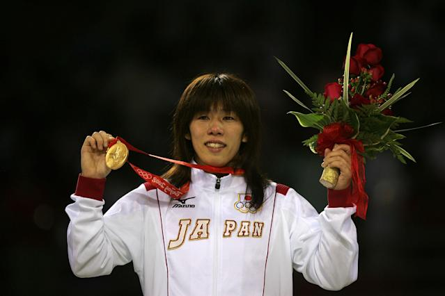BEIJING - AUGUST 16: Saori Yoshida of Japan poses with her gold medal after defeating Xu Li of China in the women's 55kg freestyle wrestling event held at the China Agriculture University Gymnasium on Day 8 of the Beijing 2008 Olympic Games on August 16, 2008 in Beijing, China. (Photo by Jeff Gross/Getty Images)