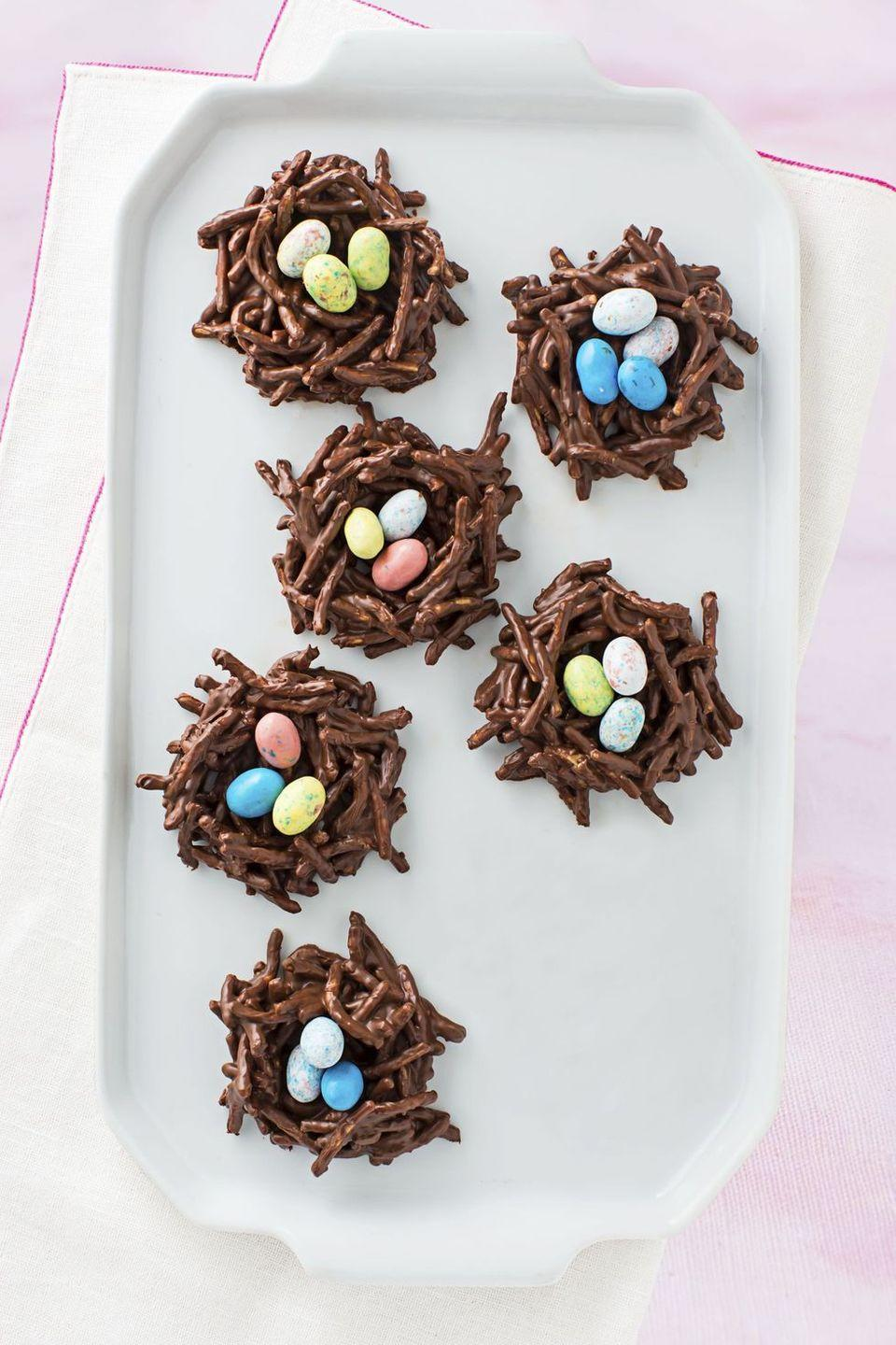 """<p>The chow mein noodle nests deliver the crunch, while the Cadbury mini eggs bring the decadent chocolate flavor. </p><p><em><a href=""""https://www.goodhousekeeping.com/food-recipes/a1530/chocolate-nests-recipe-ghk0415/"""" rel=""""nofollow noopener"""" target=""""_blank"""" data-ylk=""""slk:Get the recipe for Chocolate Nests »"""" class=""""link rapid-noclick-resp"""">Get the recipe for Chocolate Nests »</a></em></p>"""