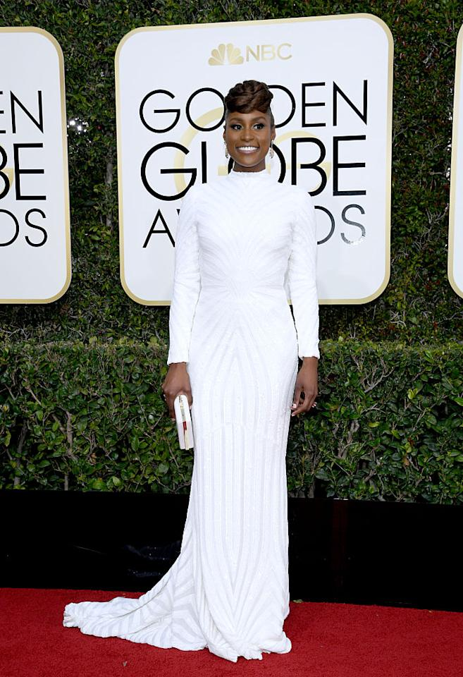 <p>Issa Rae in a custom white beaded gown by Christian Siriano. (Photo: Getty Images) </p>