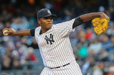 Apr 16, 2014; Bronx, NY, USA; New York Yankees starting pitcher Michael Pineda (35) delivers a pitch during the first inning against the Chicago Cubs at Yankee Stadium. Mandatory Credit: Anthony Gruppuso-USA TODAY Sports - RTR3LLCH