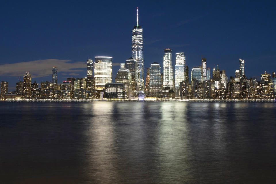 FILE - In this Dec. 28, 2018, file photo, One World Trade Center towers above the lower Manhattan skyline and the Hudson River, in New York. (AP Photo/Mark Lennihan, File)
