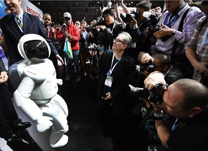 Honda North America shows off their new ASIMO Robot to the media at the 2014 New York International Auto Show, April 17, 2014 in New York City (AFP Photo/Timothy A. Clary)