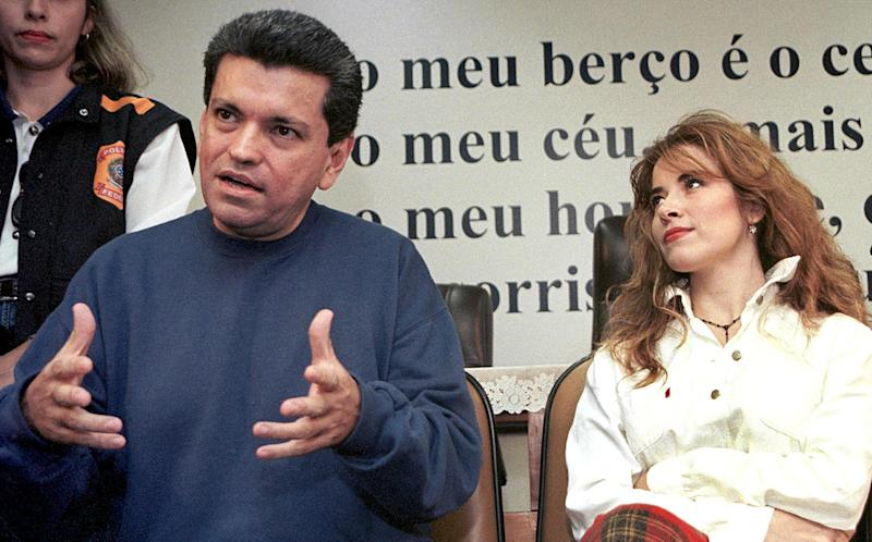 BRASILIA, BRAZIL - DECEMBER 5: File photo dated 05 December 2000 shows Sergio Andrade (L), manager of Mexican pop star Gloria Trevi (R) addressing the media at the police station in Brasilia, Brazil. The daily Correo Brasiliense 05 March, 2002 announced that DNA tests revealed that Trevi's son Angel Gabriel was fathered by Andrade. Trevi has been imprisoned in Brazil for nearly two years at the request of police in Mexico, who had hoped to extradite her to face charges that she and several associates corrupted a 17-year-old girl entrusted by her parents to Trevi's care for musical training. The singer denies the charges. AFP PHOTO FILES EVARISTO SA (Photo credit should read EVARISTO SA/AFP via Getty Images)