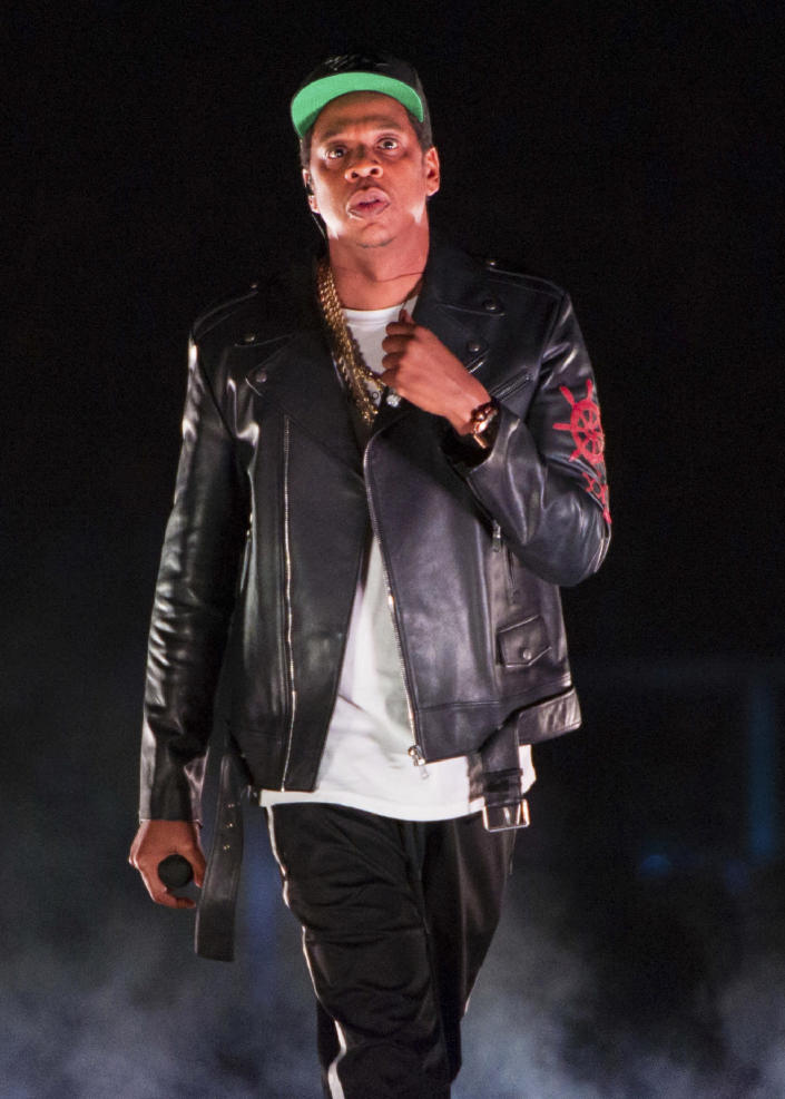 FILE - In this Nov. 26, 2017 file photo, Jay-Z performs on the 4:44 Tour at Barclays Center in New York. Jay-Z made this year's list of inductees to the Rock and Roll Hall of Fame. The ceremony, to be held at the Rocket Mortgage Fieldhouse in Cleveland, will be simulcast on SiriusXM and air later on HBO. (Photo by Scott Roth/Invision/AP, File)