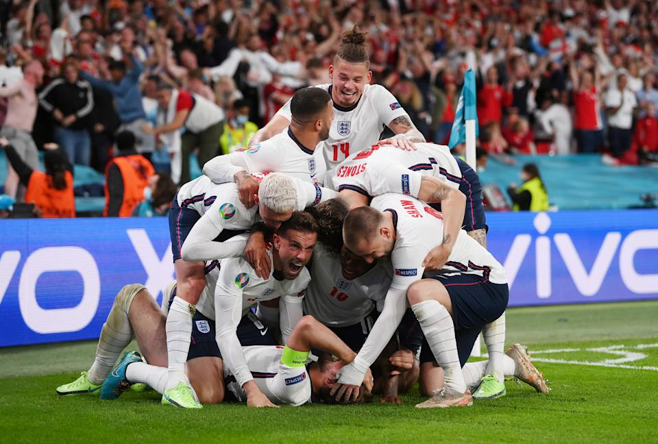 Pictured here, England players celebrate their semi-final victory at Euro 2020.
