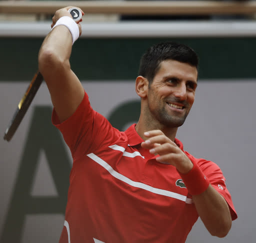 Serbia's Novak Djokovic reacts in the second round match of the French Open tennis tournament against Lithuania's Ricardas Berankis at the Roland Garros stadium in Paris, France, Thursday, Oct. 1, 2020. (AP Photo/Alessandra Tarantino)