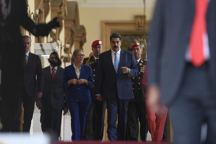 Venezuela's President Nicolas Maduro arrives for a press conference at the Miraflores Presidential Palace in Caracas, Venezuela, Thursday, March 12, 2020. Maduro has suspended flights to Europe and Colombia for a month, citing concerns for the new coronavirus. Maduro added in a national broadcast that the illness has not yet been detected in Venezuela, despite it being confirmed in each bordering country, including Colombia, Brazil and Guyana. (AP Photo/Matias Delacroix)