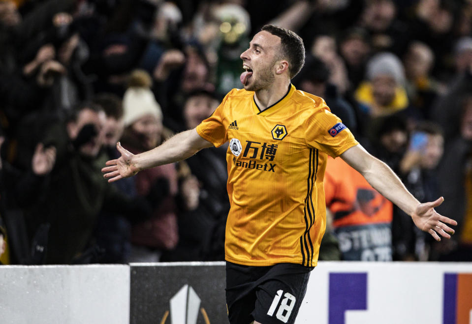 WOLVERHAMPTON, ENGLAND - DECEMBER 12: Wolverhampton Wanderers' Diogo Jota celebrates scoring his side's first goal during the UEFA Europa League group K match between Wolverhampton Wanderers and Besiktas at Molineux on December 12, 2019 in Wolverhampton, United Kingdom. (Photo by Andrew Kearns - CameraSport via Getty Images)