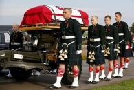 Soldiers escort the coffin during the funeral procession for Cpl. Nathan Cirillo in Hamilton, Ontario October 28, 2014. REUTERS/Mark Blinch