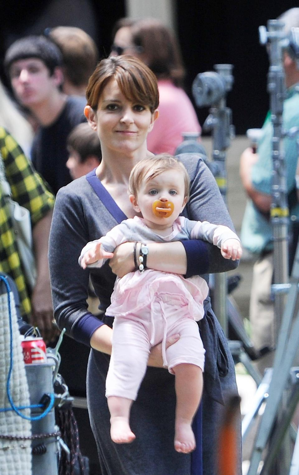 """<p>The comedian was 41 when she had her second child, baby girl Penelope. She <a href=""""http://people.com/babies/tina-fey-baby-born-daughter-penelope-athena/"""" rel=""""nofollow noopener"""" target=""""_blank"""" data-ylk=""""slk:talked"""" class=""""link rapid-noclick-resp"""">talked</a> with Oprah about wanting to prioritize expanding her family: """"My husband and I really decided that we felt rather than risk having <em>30 Roc</em>k end in several years and feeling like part of our family is missing that we were going to prioritize our family,"""" she said. (Photo: Bobby Bank/Getty Images) </p>"""