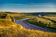 """<p><strong>Best camping in North Dakota:</strong> Cottonwood Campground, Theodore Roosevelt National Park</p> <p>Often touted as the landscape that made Roosevelt into the """"conservationist president,"""" North Dakota's colorful badlands, cheerful prairie dog towns, and herds of bison combine to make the national park a wonder to behold. Set on the banks of the Little Missouri River, Cottonwood Campground offers excellent wildlife viewing, plus fire rings and picnic tables for nights around the campfire.</p>"""