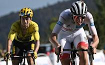 'Ruthless fight': after a battle that stretched over most of the Tour and included a struggle in the snow up the Grand Colombier, Tadej Pogacar (right) took the yellow jersey off Primoz Roglic