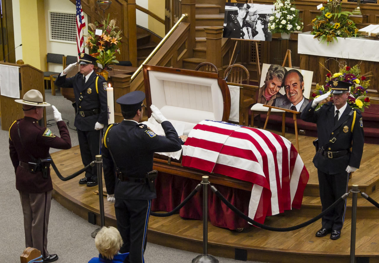 Members of the honor guard salute at the public viewing for former Democratic U.S. senator and three-time presidential candidate George McGovern at the First United Methodist Church in Sioux Falls, S.D., Thursday, Oct. 25, 2012. McGovern died Sunday in his native South Dakota at age 90. (AP Photo/Nati Harnik)