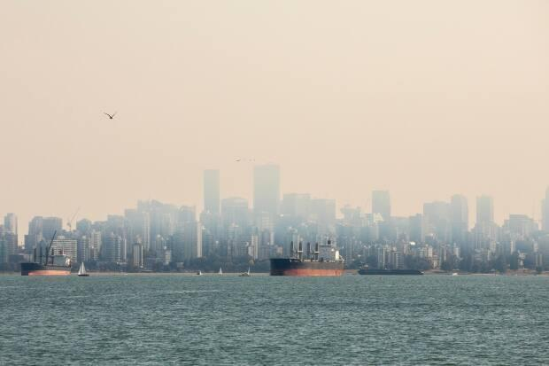 Smoke over downtown Vancouver last year. Scientists are warning residents to prepare for similar conditions as nearly 300 wildfires burn in B.C. (Ben Nelms/CBC - image credit)