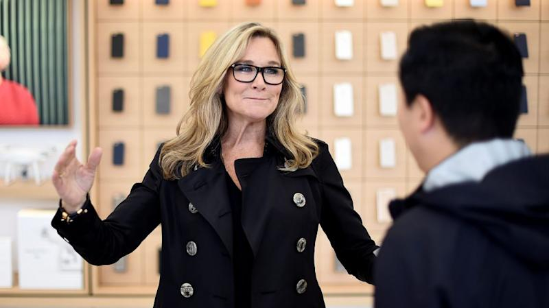 Apple's Angela Ahrendts talks to an employee