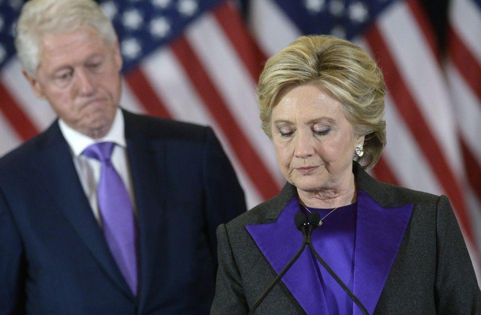 Bill and Hillary Clinton during her speech. Photo: AAP