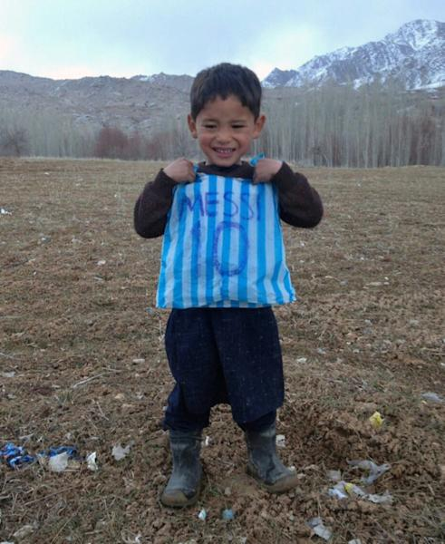 Murtaza Ahmadi's brother made him a makeshift jersey out of a blue and white striped plastic bag, with Messi's name and famous number 10 written carefully on the back in felt-tip pen