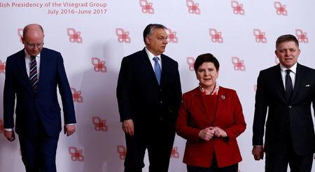 Visegrad Group (V4) member nations' Prime Ministers, Bohuslav Sobotka of the Czech Republic, Hungary's Viktor Orban, Poland's Beata Szydlo and Slovakia's Robert Fico pose for a family photo during a summit in Warsaw, Poland March 2, 2017.  REUTERS/Kacper Pempel
