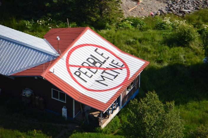 """A resident of Pedro Bay, Alaska, has painted a rooftop symbol opposing the Pebble Mine. <span class=""""copyright"""">(Richard Read / Los Angeles Times)</span>"""