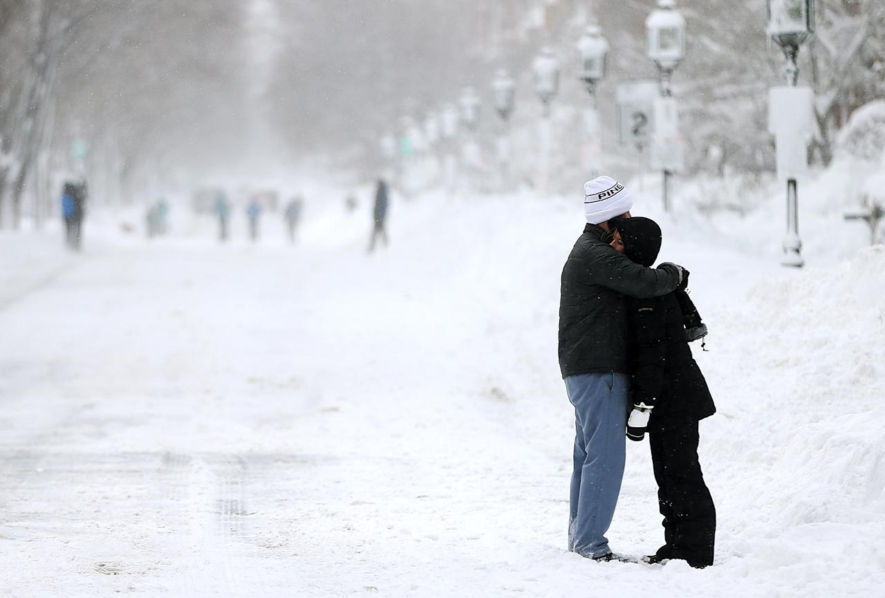 BOSTON, MA - FEBRUARY 09:  Michael Greely hugs Rebecca Ferrel on Commonwealth Avenue following a powerful blizzard on February 9, 2013 in Boston, Massachusetts. The storm knocked out power to 650,000 and dumped more than two feet of snow in parts of New England.  (Photo by Mario Tama/Getty Images)