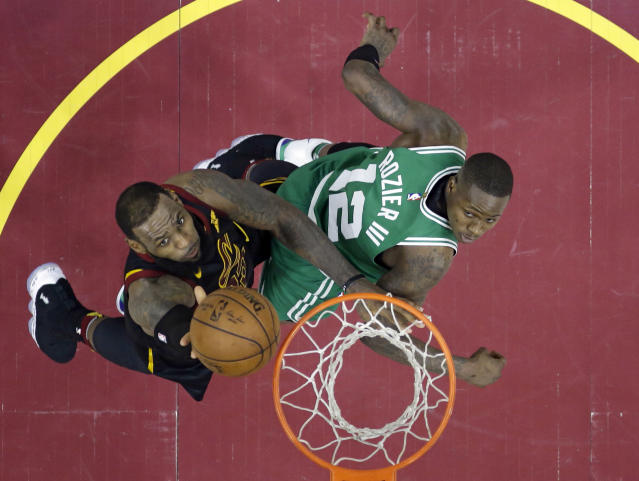 LeBron James gets a second-half bucket against Terry Rozier and the Celtics on Saturday night. (AP)