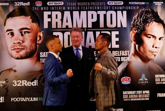 Boxing - Carl Frampton & Nonito Donaire Public Work-Outs - Victoria Square Shopping Centre, Belfast, Britain - April 18, 2018 Carl Frampton and Nonito Donaire pose with promoter Frank Warren after a press conference Action Images via Reuters/Jason Cairnduff