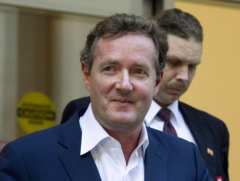 """FILE - In this Dec. 20, 2011 file photo, Piers Morgan, host of CNN's """"Piers Morgan Tonight,"""" leaves the CNN building in Los Angeles. Former U.S. President Bill Clinton's convention speech nominating President Barack Obama for a second term left Morgan star-struck: """"Already the best speech of either convention,"""" the prime-time talk show host tweeted. """"An oratorical genius right up there with Churchill, Kennedy, MLK and Mandela."""" (AP Photo/Jae C. Hong, File)"""