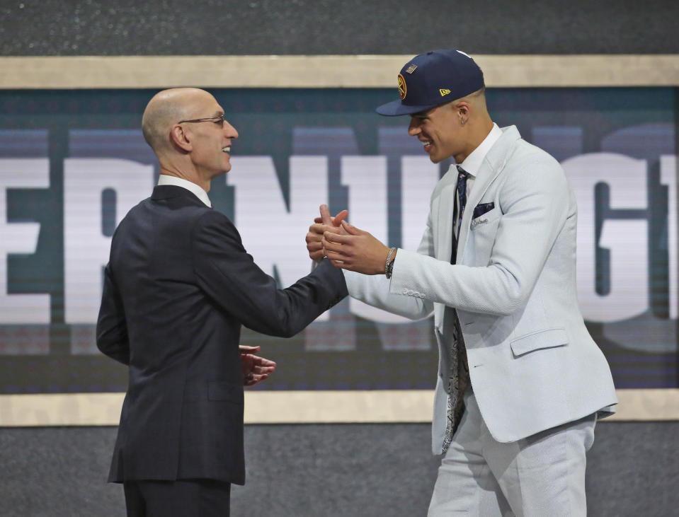 Michael Porter Jr. of Missouri, right, poses with NBA Commissioner Adam Silver after he was picked 14th overall by the Denver Nuggets during the first round of the NBA basketball draft in New York, Thursday, June 21, 2018.