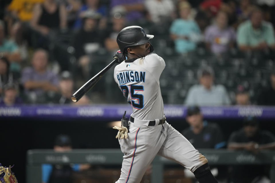 Miami Marlins right fielder Lewis Brinson (25) in the eighth inning of a baseball game Saturday, Aug. 7, 2021, in Denver. (AP Photo/David Zalubowski)