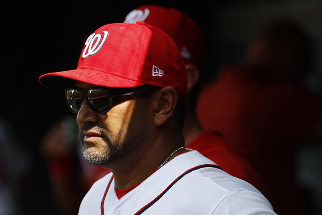 Washington Nationals manager Dave Martinez stands in the dugout in the seventh inning of a baseball gameagainst the New York Mets, Wednesday, Sept. 4, 2019, in Washington. (AP Photo/Patrick Semansky)