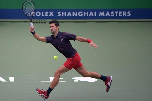 Novak Djokovic of Serbia hits a return during his first round men's doubles match against Kevin Krawietz and Andreas Mies of Germany at the Shanghai Masters tennis tournament in Shanghai (AFP Photo/NOEL CELIS)