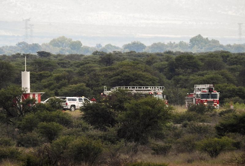 Fire engines are seen near the wreckage of a plane that crashed with 97 passengers and four crew on board on take off at the airport of Durango in northern Mexico