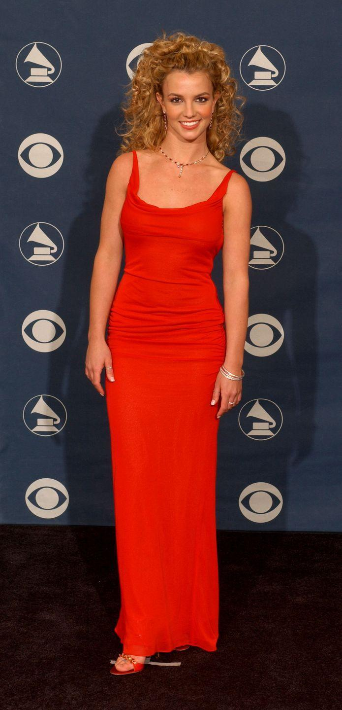 <p>Britney Spears poses at the 44th Annual Grammy Awards on February 27, 2002.</p>
